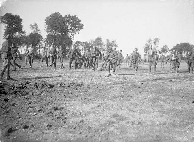 English soldiers play football in France 1916, Courtesy of Imperial War Museum