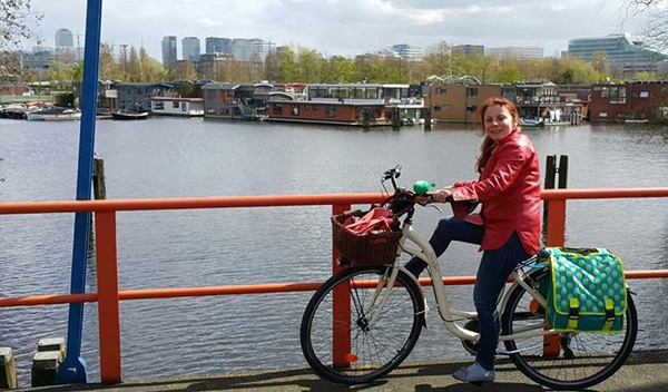 Photograph of Tatiana Reznichenko cycling through Spinoza's homeland, the Netherlands