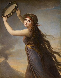 'Portrait of Emma, Lady Hamilton as a Bacchante'. Painting by Elizabeth Vigée le Brun. Image shows a young woman with long hair dressed in a classical robe and hodling a tambourine aloft.