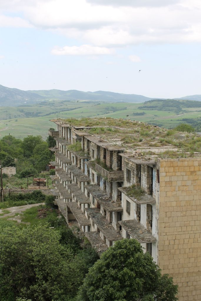 Photograph of abandoned buildings that bear quiet testimony to the Armenian–Azerbaijani conflict.