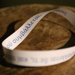 Photograph of Möbius strip with greek lettering