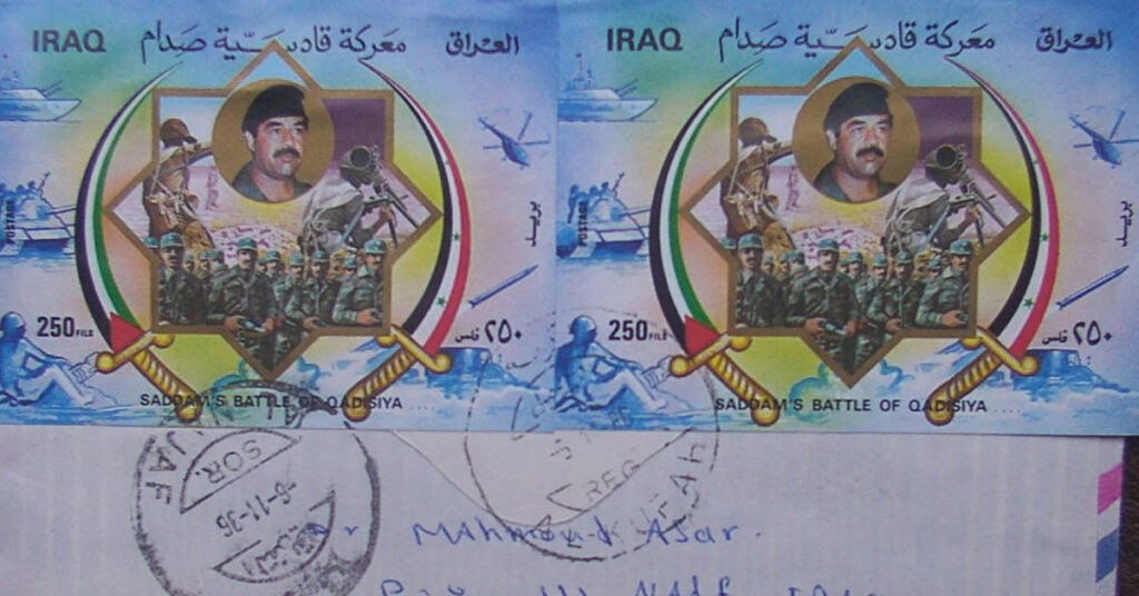 A letter with large Iraqi stamps depicting Saddam Hussein.