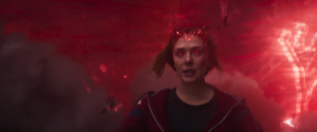 Wanda unleashes her full power. Photo: from Marvel Studios/Disney+ Wandavision (2021). Wanda, a woman with red glowing eyes, is surrounded by a red mist.