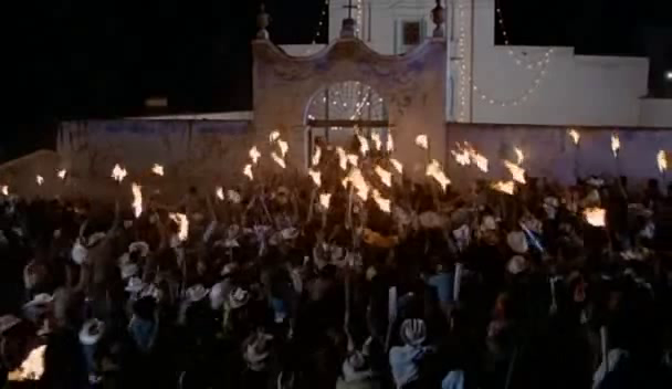 A mob wields flaming torches in a frame from Canoa: A Shameful Memory (1976)