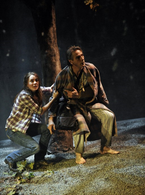 Colm (Jeremy Irons) and Barbara (Joanna Horton) retreat from the falling ash in The Gods Weep