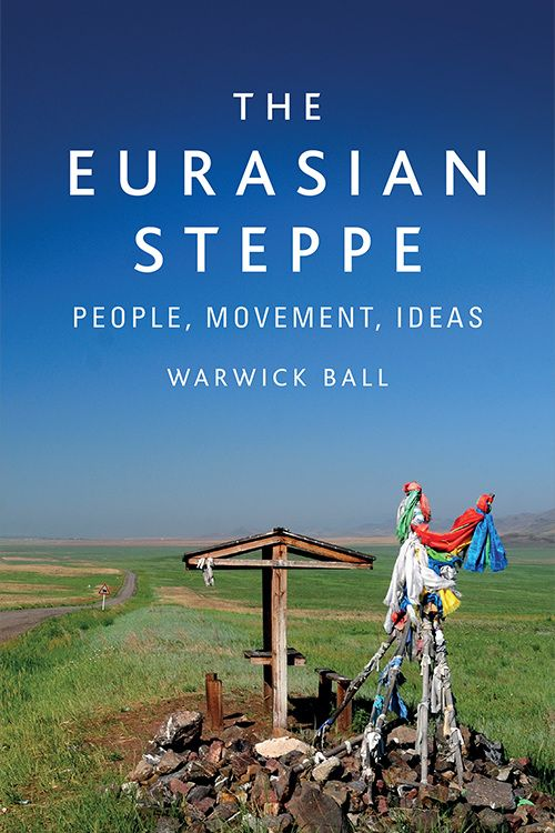 The cover image of The Eurasian Steppe showing a cloth-wrapped shrine in the foreground and a huge blue sky in the background, photo taken by Warwick Ball.
