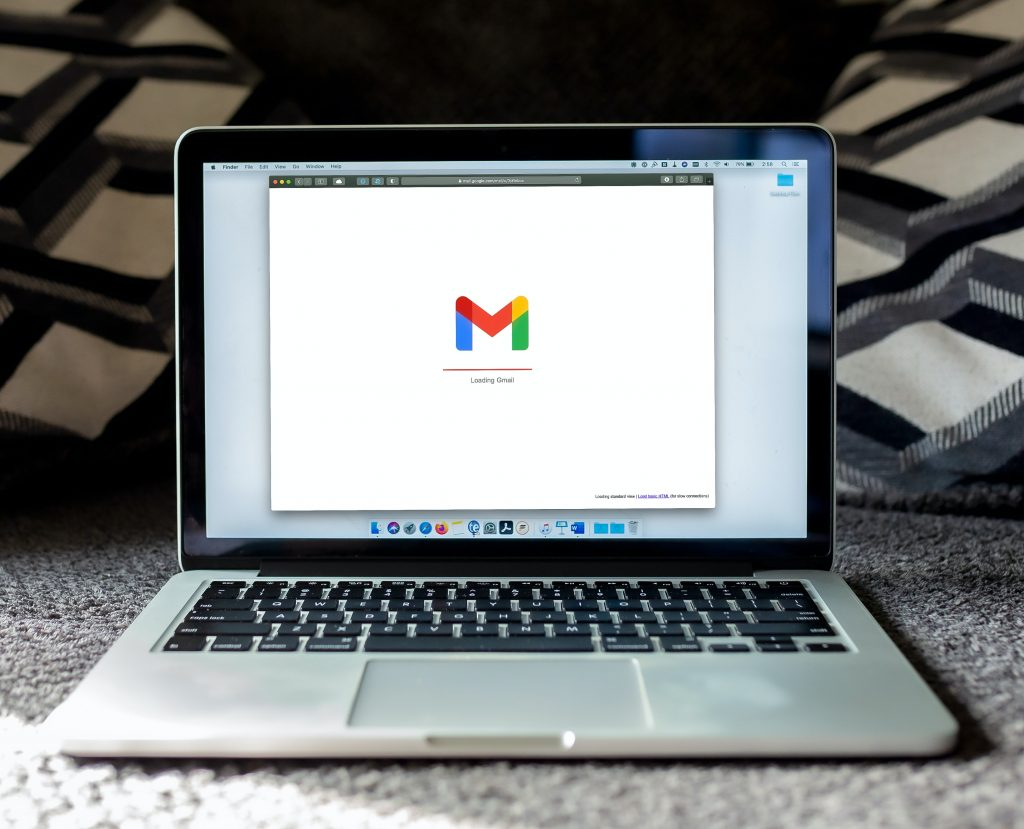 An open Mac laptop with Gmail displayed on the screen