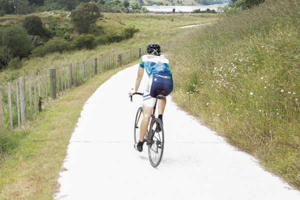 A man is cycling through a field